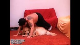 Dirty tattooed MILF getting threesome with two dogs