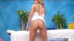 Blonde sexy masseuse's so hot beside massage table